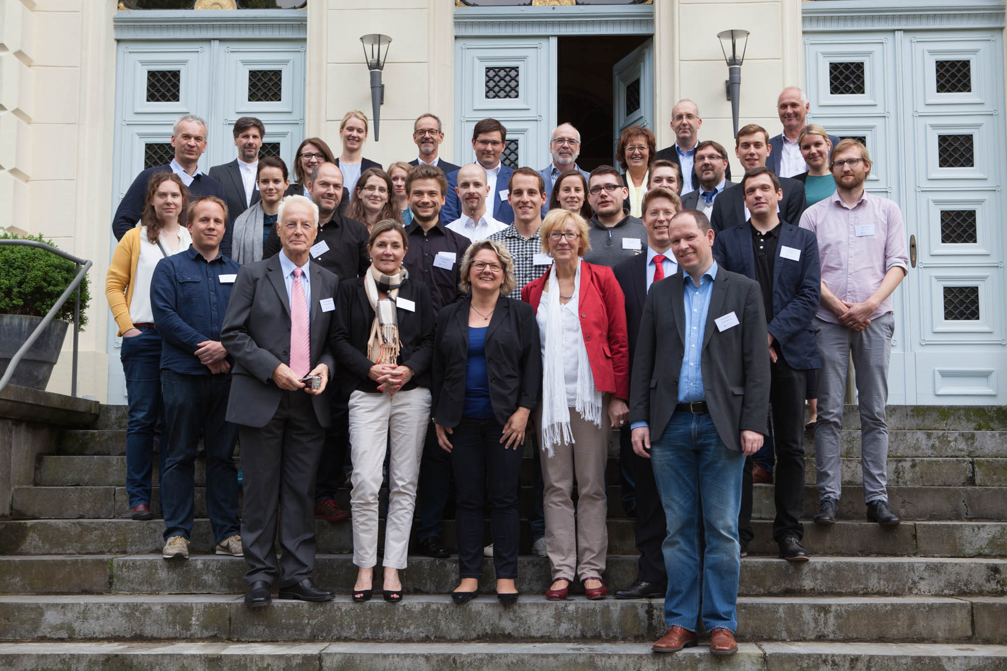 "Members of the NRW Fortschrittskolleg ""Online Participation"" together with NRW State Minister for Innovation, Science and Research, Svenja Schulze, at a workshop in June 2016"